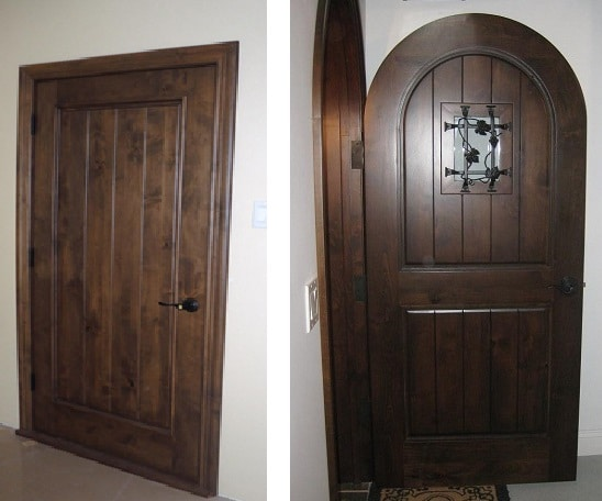 Elegantly designed wine cellar doors made from strong wood.