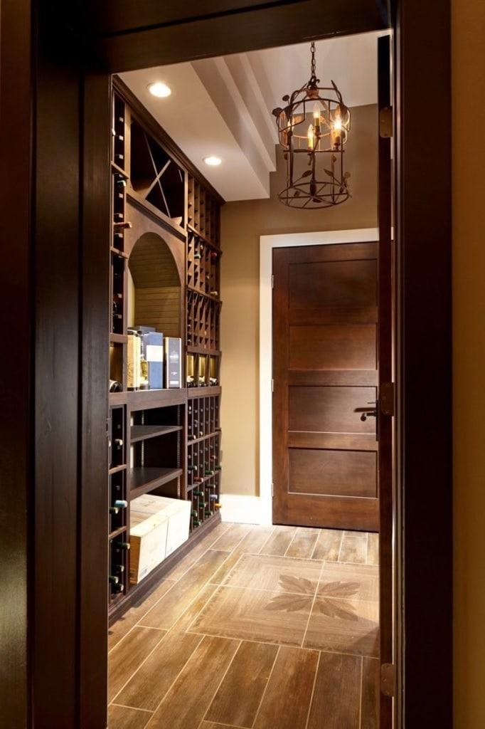 Rustic designed home custom wine cellar built using wooden for Custom interior design